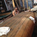 Jens and Fung at work on a 1930 Old Town Canoe