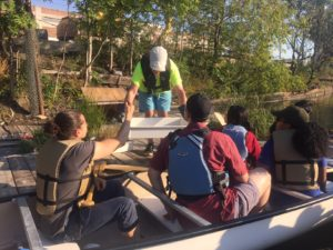Patterson shows wildlife thriving in the Living Dock to a class from St. Joseph College