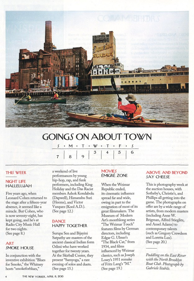The North Brooklyn Boat Club photographed paddling by the Domino Sugar Factor on the East River